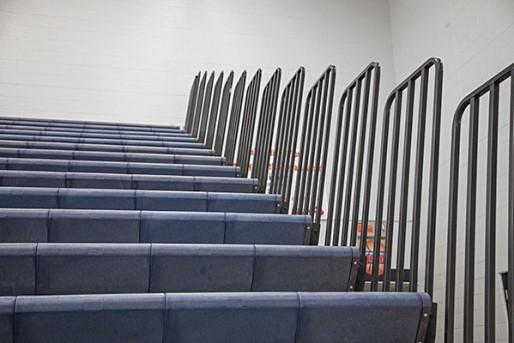 Indoor bleacher repairs -- Safety bleacher end rails